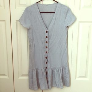Silver colored short sleeve dress. Button up front